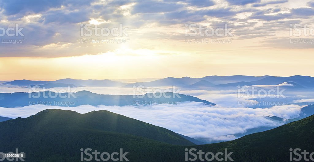 Summer cloudy sunrise mountain panorama stock photo