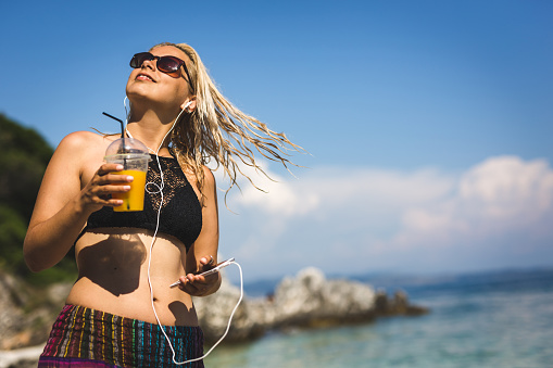 617378218 istock photo Summer, cocktail and music 979216538