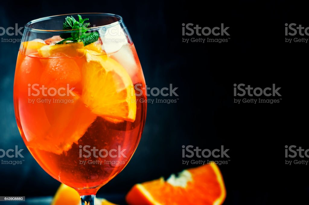 Summer cocktail aperitif with orange bitter, fruit, ice and soda – Foto