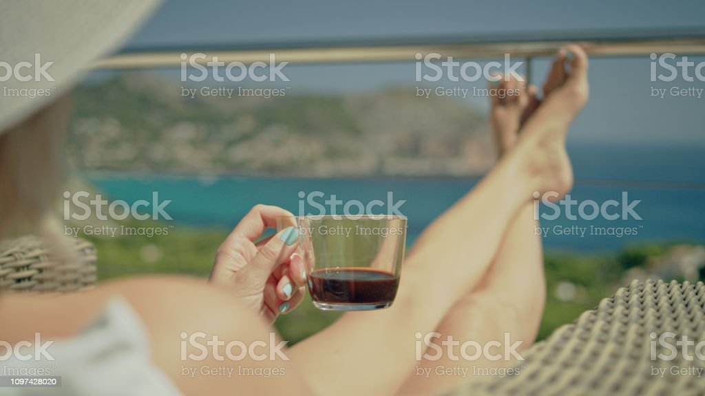 Beautiful woman relaxing on a terrace. Having lunch and coffee....