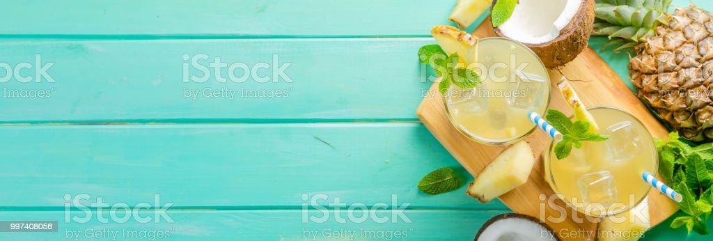 Summer coffee cocktail with coconut and pineapple, copy space