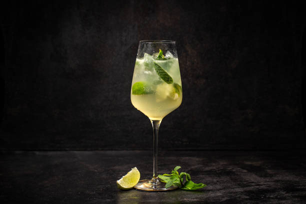 Summer cold drink Summer cold drink with lemon, mint and ice on black background mojito stock pictures, royalty-free photos & images
