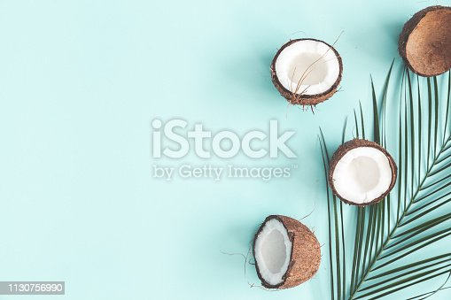 istock Summer composition. Coconut, palm leaf on pastel blue background. Summer concept. Flat lay, top view, copy space 1130756990