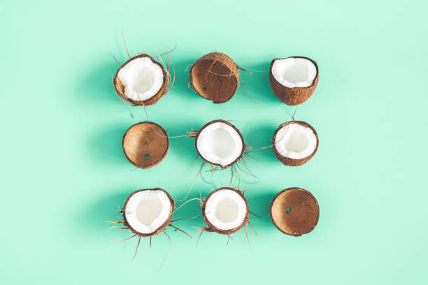 Summer composition. Coconut pattern on mint background. Summer concept. Flat lay, top view stock photo