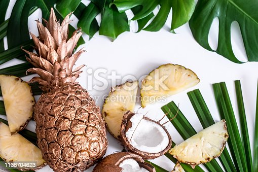 1153498948 istock photo summer composition with tropical leaves and fruits on white background 1138704623