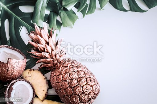 1153498948 istock photo summer composition with tropical leaves and fruits on white background 1142532772