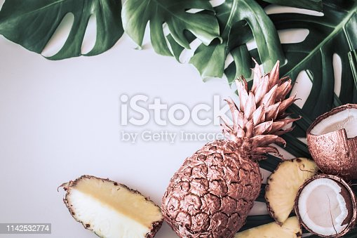 1153498948 istock photo summer composition with tropical leaves and fruits on white background 1142532774