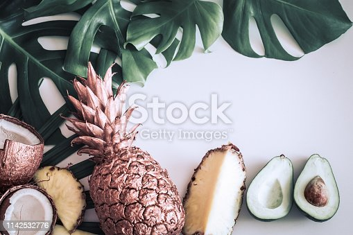 1153498948 istock photo summer composition with tropical leaves and fruits on white background 1142532776