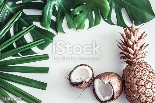 1153498948 istock photo summer composition with tropical leaves and fruits on white background 1145173429
