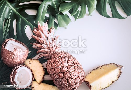 1153498948 istock photo summer composition with tropical leaves and fruits on white background 1145173433