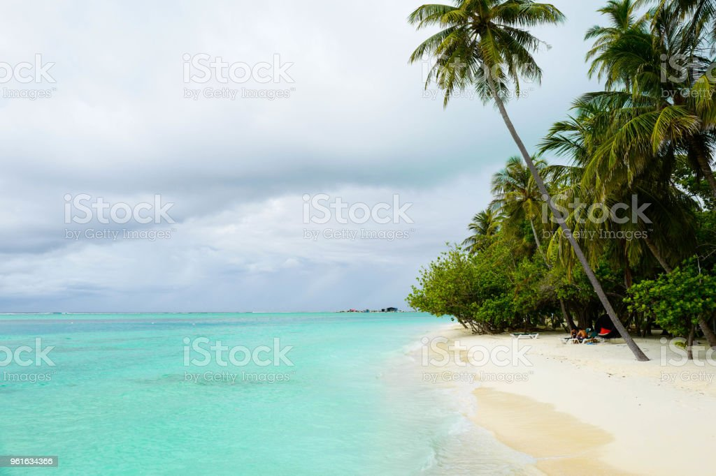 Summer concept , Beach white sand and turquoise sea color at maldives on the weekend holidays stock photo