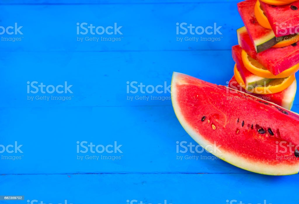 Summer concept : Sliced watermelon on blue rustic wood background. royaltyfri bildbanksbilder