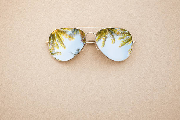 Summer concept, sunglasses in the sand stock photo