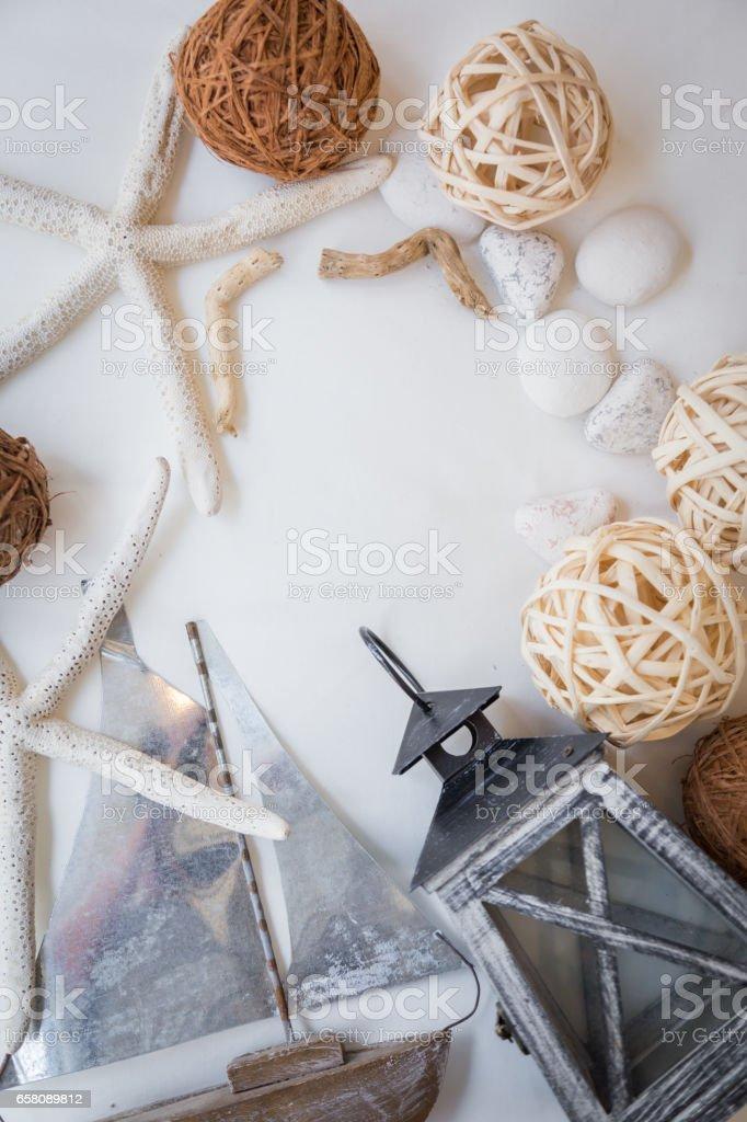 summer concept with boat starfish lantern stone rattan ball royalty-free stock photo