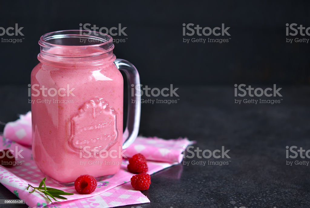Summer cool drink, a smoothie with raspberry and peach royalty-free stock photo