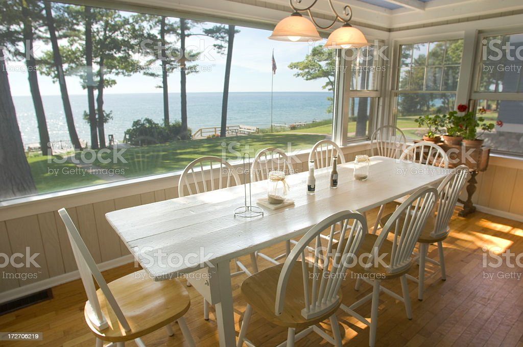 Summer cottage on the lake with chairs stock photo