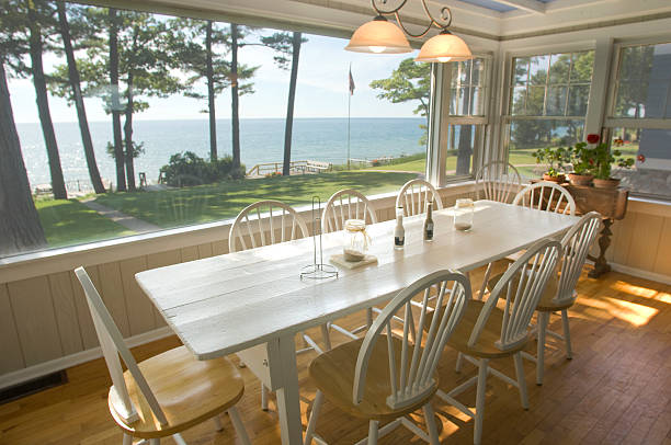 Summer cottage on the lake with chairs Dining Room at a summer cottage on the lake. promenade stock pictures, royalty-free photos & images