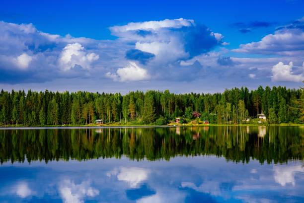 Summer cottage or log cabin by the blue lake in rural Finland. stock photo