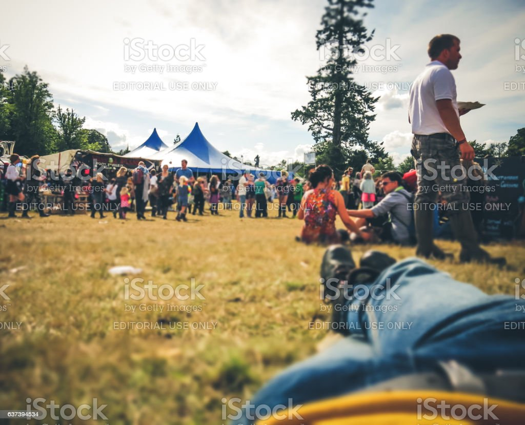 Summer Crowd of People Festival Celebration Resting Point Of View stock photo
