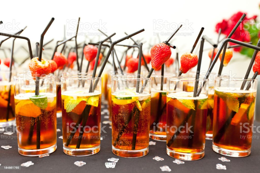 Summer Cup with fruit and straws at a party stock photo