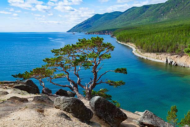 summer day on lake baikal - siberië stockfoto's en -beelden