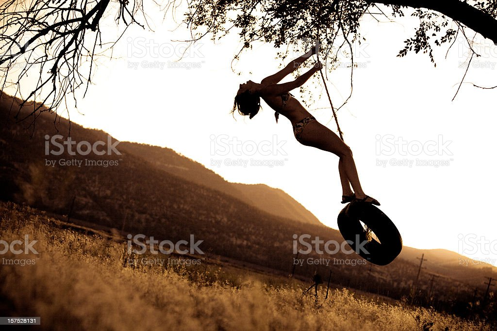 Summer daydreaming on a rope swing royalty-free stock photo