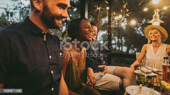 Photo of a friends having fun on a dinner party