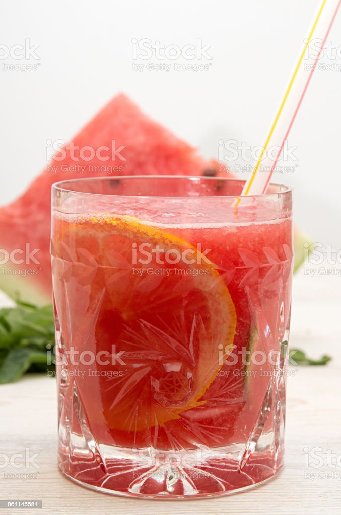 Summer drink watermelon smoothie juice in glass with cocktail tube and watermelon slice on white background. Watermelon lemon cocktail. Healthy vegetarian food. royalty-free stock photo