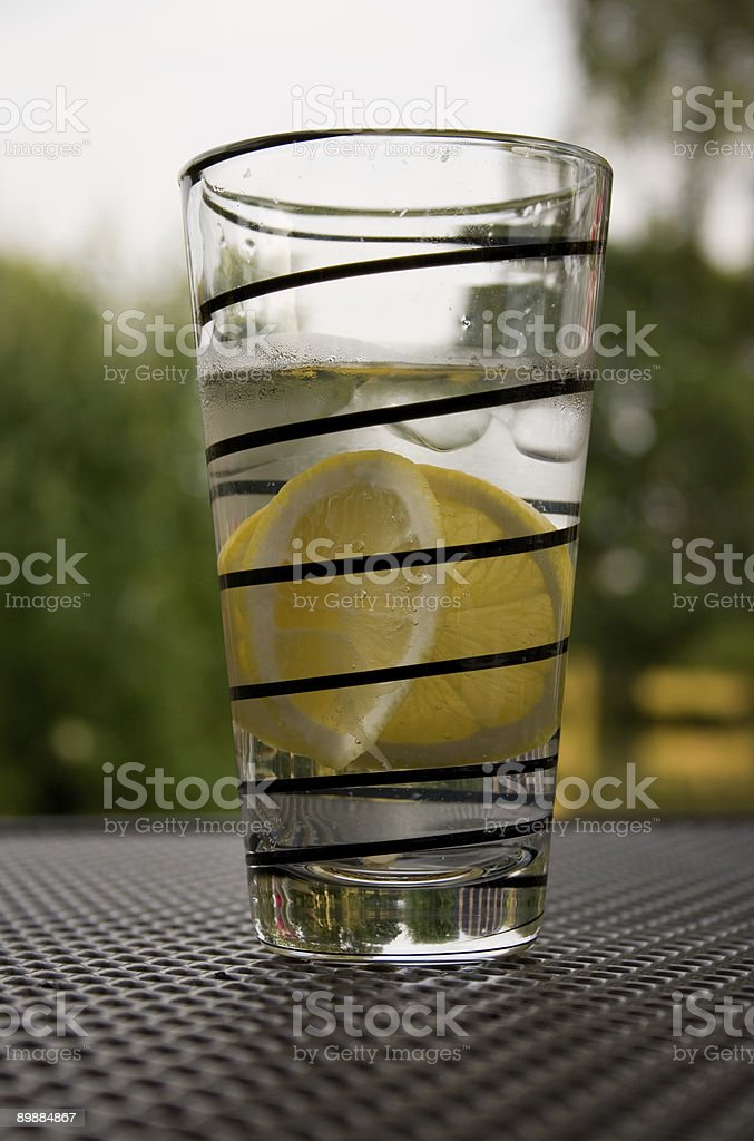Summer drink with lemon and ice royalty-free stock photo