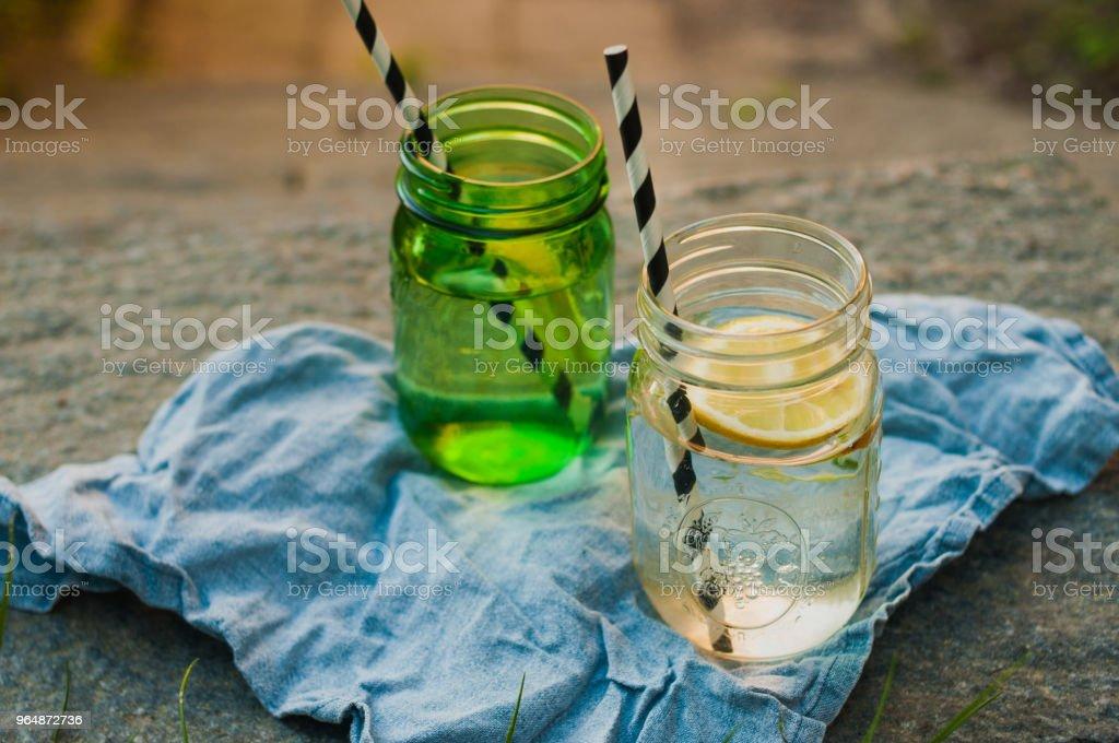 Summer drinks outdoors still life sunshine lemon mason jar royalty-free stock photo