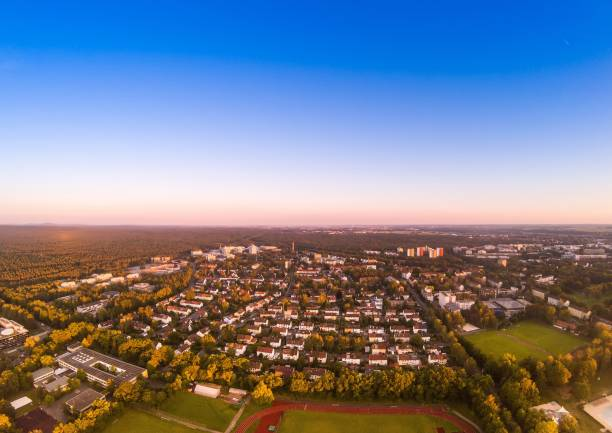 Summer evening aerial image of the city of Erlangen in Bavaria in Germany Summer evening aerial image of the city of Erlangen in Bavaria in Germany shot with drone erlangen stock pictures, royalty-free photos & images