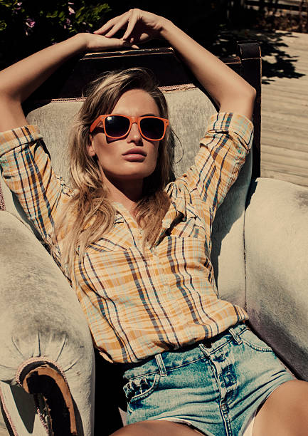 summer fashion blond women - jean shorts stock photos and pictures