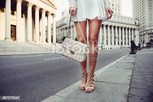 istock summer female casual street style outfit with luxury bag 857575042