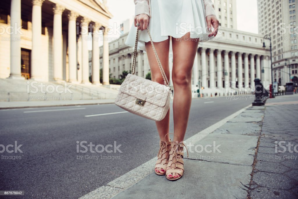 summer female casual street style outfit with luxury bag stock photo