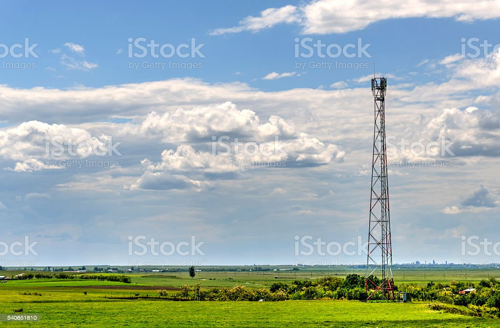 Summer Field Landscape And Telecommunication Tower stock photo