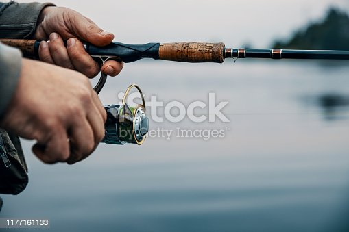 914030378 istock photo Summer fishing on the river in the early morning. Fishing background. 1177161133