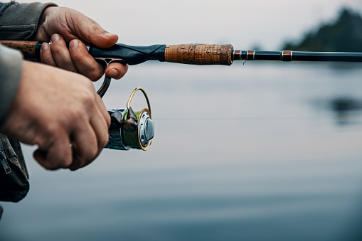 115874504 istock photo Summer fishing on the river in the early morning. Fishing background. 1177161133