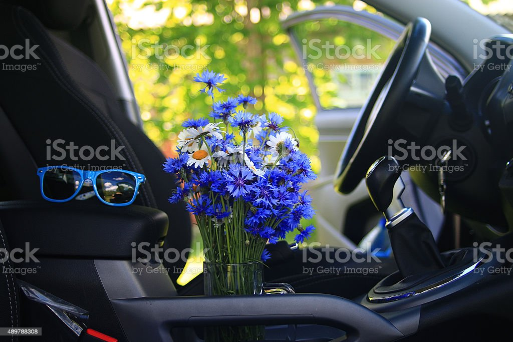 Summer flowers in the car stock photo