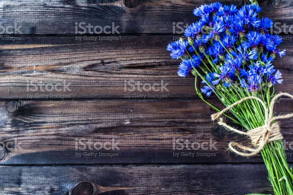 Summer flowers on wood, vintage design, copy space stock photo