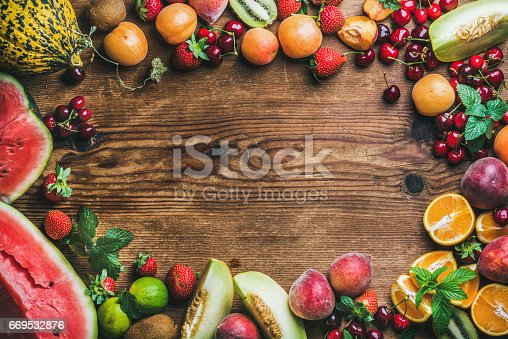 841659594 istock photo Summer fresh fruit variety over rustic wooden background 669532876