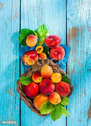 Summer fruits on old blue wooden.