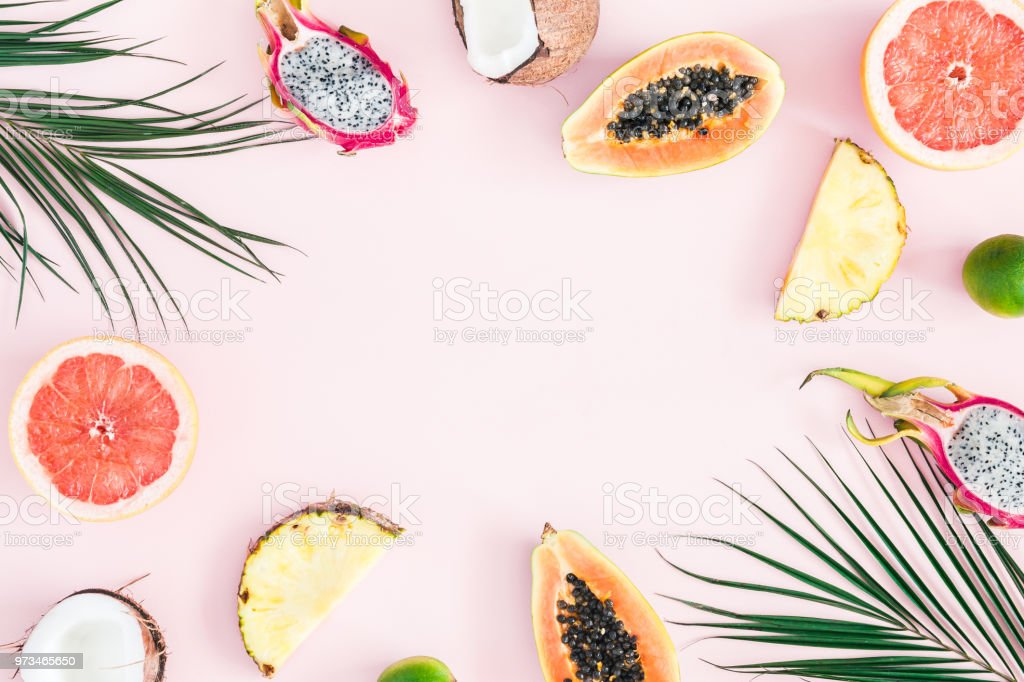 Summer fruits on pastel pink background. Flat lay, top view stock photo