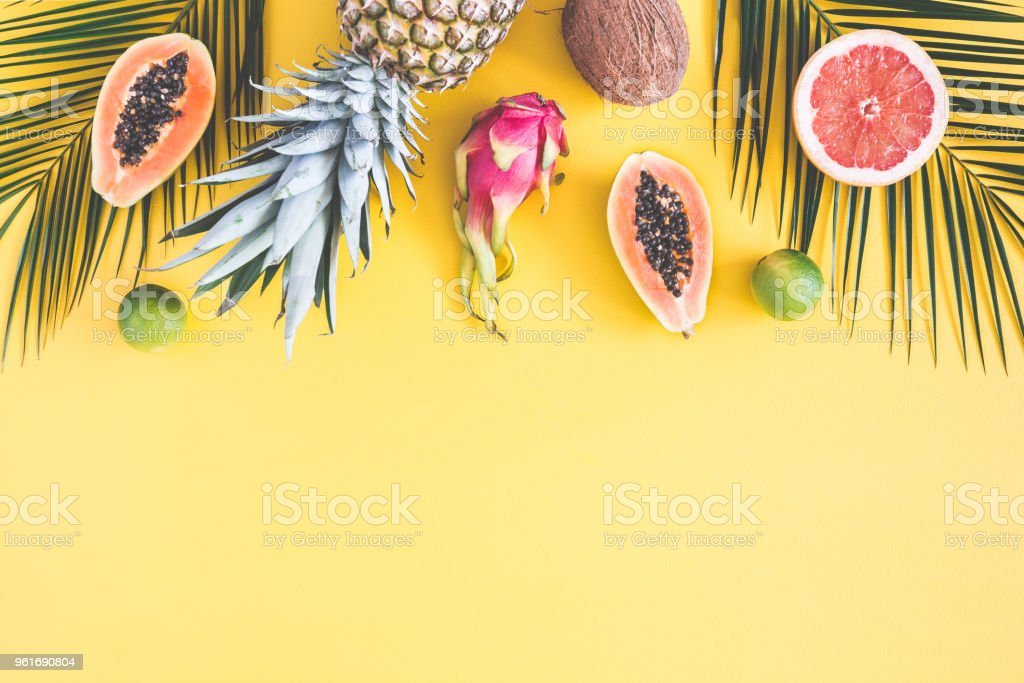Summer fruits on yellow background. Flat lay, top view stock photo