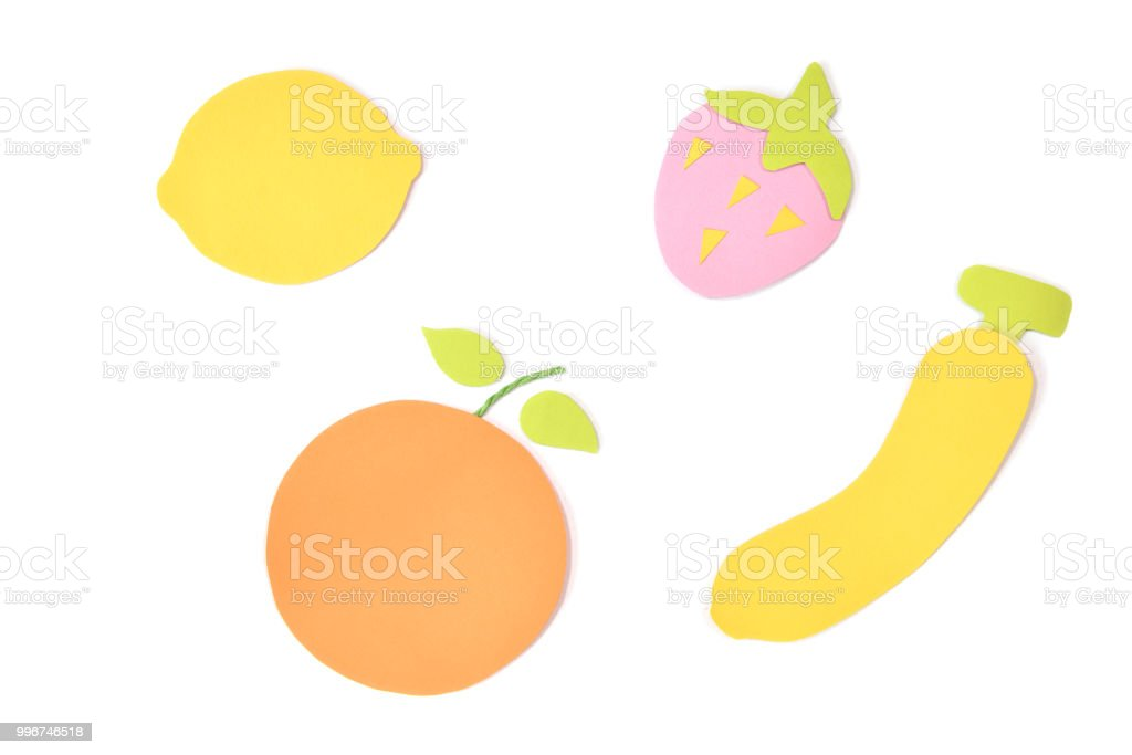 Summer fruits paper cut on white background stock photo