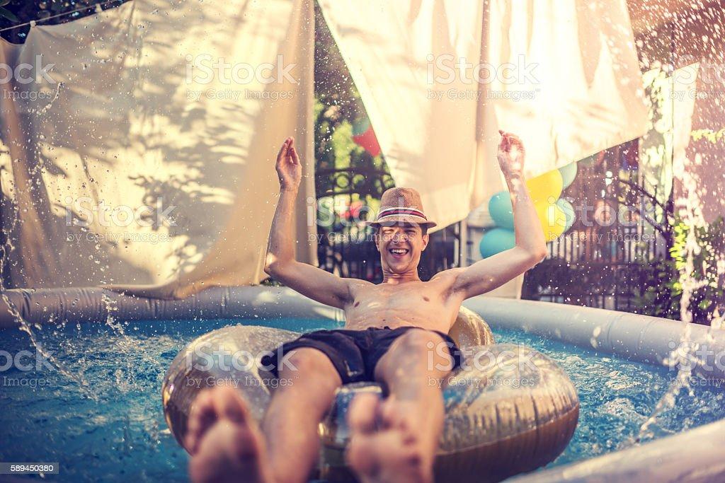 Summer fun in a pool stock photo
