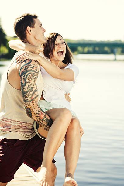 sommerspaß - lausbub tattoo stock-fotos und bilder