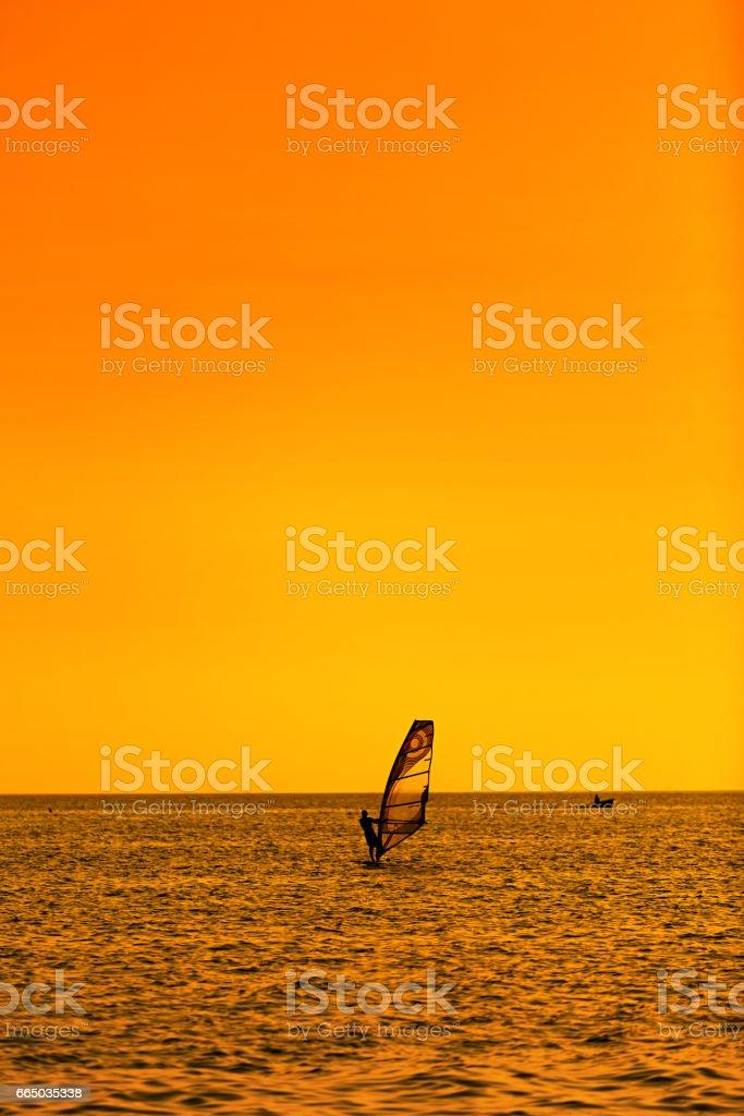 Summer Fun With Recreational Water Sport Windsurfing. Windsurfer...