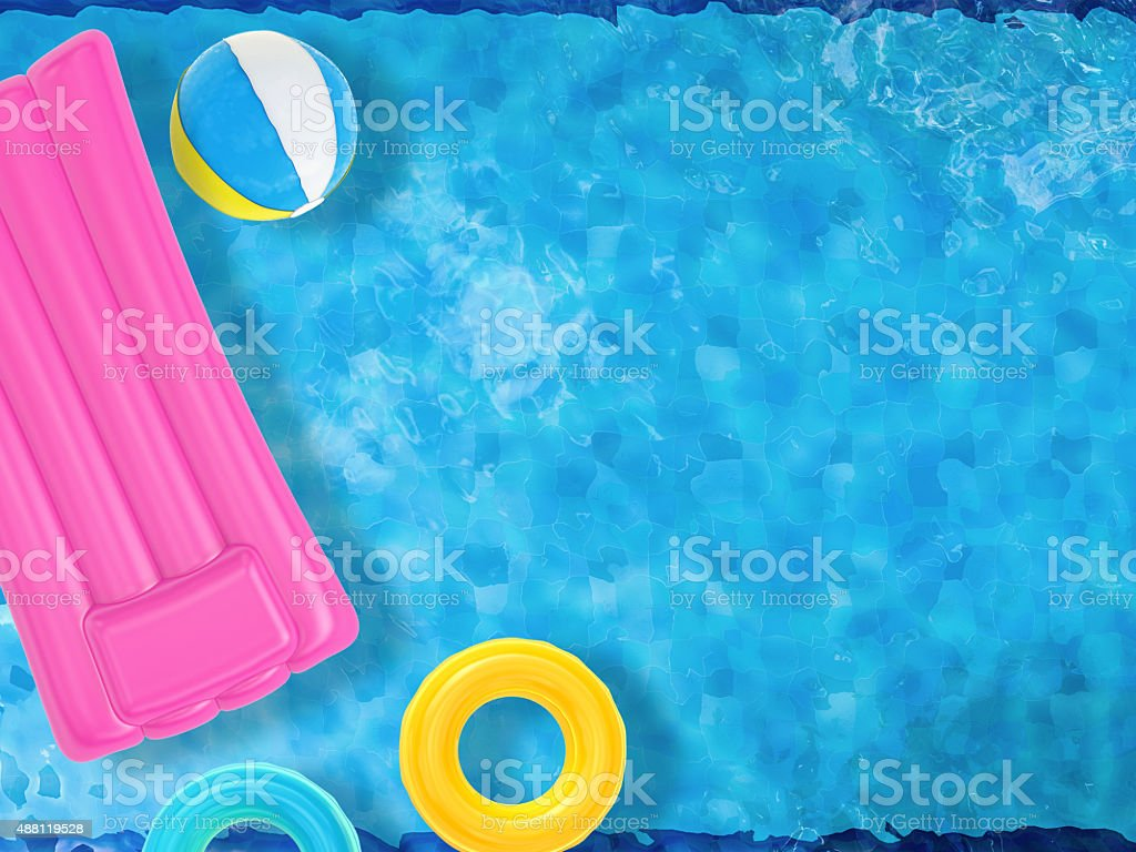 summer fun with inflatable toys floating on pool top view stock photo