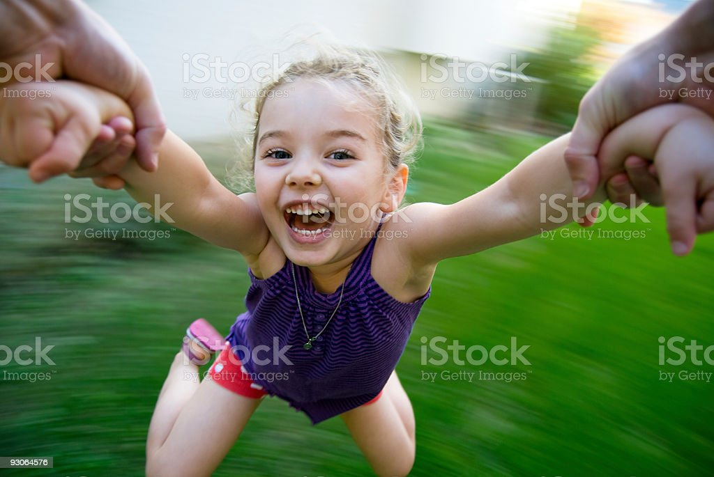Summer fun! Young girl spinning royalty-free stock photo