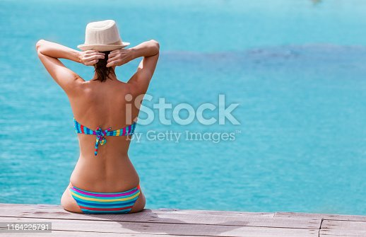 Woman enjoying summer getaway.